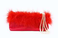 Party Girl - red silk evening bag with pearls Stock Photos