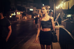 Party girl. Girl`s night out in a black dress Stock Photography