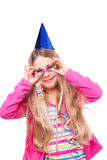 Party girl with streamers. Cute party girl holding streamers in front of her eyes royalty free stock photos