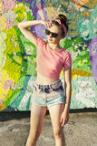 Party girl. A young girl on the background of graffiti. Party girl. Teenager Stock Photos