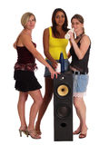 Party girls. Three young women standing around a speaker Royalty Free Stock Photo