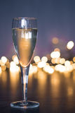 Party glass out of focus lights Royalty Free Stock Image