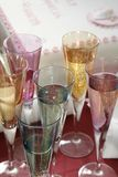 Party Glasses. Multi-colored party glasses set out in preparation for toast with birthday behind Stock Image