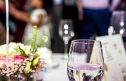 Party and glasses with the guest in the background Royalty Free Stock Photography