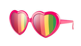 Party glasses. A pair of pink heart shaped pair of glasses with rainbow in the lenses, isolated on white Royalty Free Stock Photography