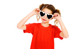 Party glasses. Portrait of a cheerful girl wearing party sunglasses smiling at camera. Isolated over white Stock Photo