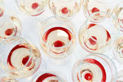 Party glasses with red cherry drink Stock Image