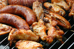 Party grill. Chicken meat and sausage grilled on barbecue Royalty Free Stock Photos