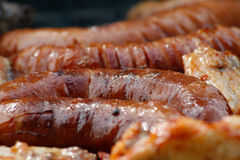 Party grill. Chicken meat and sausage grilled on barbecue Stock Photography
