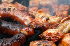 Party grill. Chicken meat and sausage grilled on barbecue Stock Image