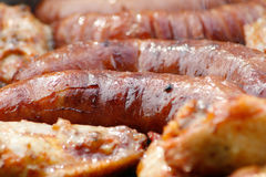 Party grill. Chicken meat and sausage grilled on barbecue Royalty Free Stock Photo