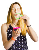 Party guest blowing bubbles of congratulations Stock Image