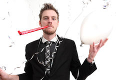 Party guy holding a balloon Royalty Free Stock Images