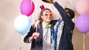 Party guys dancing in photo booth. Happy party guys dancing in photo booth stock video footage