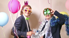 Party guys dancing in photo booth. Happy party guys dancing in photo booth stock footage