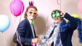 Party guys dancing in photo booth. Happy party guys dancing in photo booth, graded stock footage
