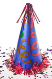 Party hat. Shiny party hat on background with confetti stock photo