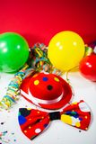 Party hat with bow, balloons and streamers stock image