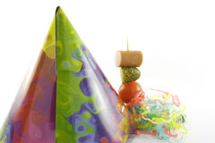 Party Hat with Cocktail Stick and Streamers stock image