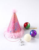Party hat with colorful baubles and bells Royalty Free Stock Photo