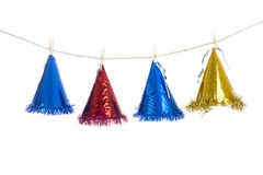 Party hat hanging isolated on white. Hanging party hats isolated on white Royalty Free Stock Image
