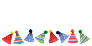 Party hats border. Colorful party hats border with copy space stock photography