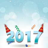 2017 party hats and confetti background. New Year Twenty Seventeen in Numbers with Party Hats Over Blue Background With Snow Royalty Free Stock Photography