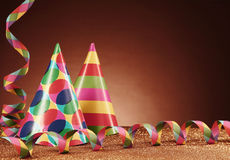 Party Hats with Different Designs and Streamers Royalty Free Stock Photo