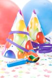Party hats, horns or whistles, confettis Stock Photo