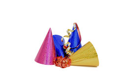 Party Hats. Pink, blue and gold metallic looking party hats with red and gold streamers isolated on a white background Stock Image