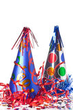 Party hats, streamers and confetti royalty free stock images