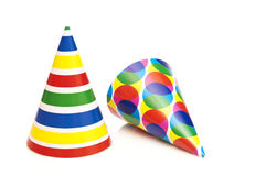 Party hats. Two coloured party hats before white background royalty free stock photography