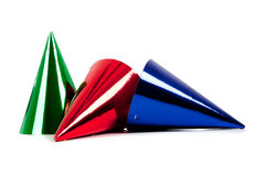 A party hats on a white background. Assorted party hats including red, green, and blue on a white background with copy space royalty free stock photography