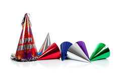 Party hats on a white background. Red, silver, green and blue party hats on a white background royalty free stock photography