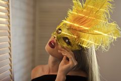 Party, holiday, celebration. love games Beauty, look, makeup. Sensual woman wear carnival mask with feather, fashion. Fashion, accessory, style Girl with royalty free stock photo