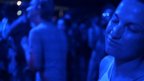 Party, holidays, celebration, nightlife and people concept - smiling friends dancing in club or open air stock footage