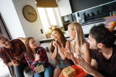 Party in honor of the birthday. Guests give their gifts to the birthday girl. The girl is very happy to receive gifts. Stock Photo