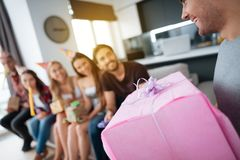 Party in honor of the birthday. Guests give their gifts to the birthday girl. The girl is very happy to receive gifts. Stock Photography
