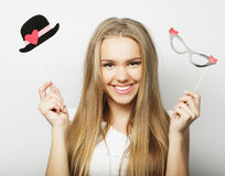 Party image. Playful young woman holding a party glasses. Stock Image