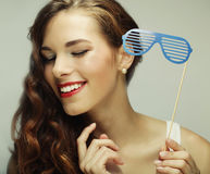 Party image. Playful young women holding a party glasses. Stock Images