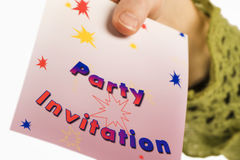 Party invitation. Someone's hand giving a party invitation. Isolated on white background Stock Image