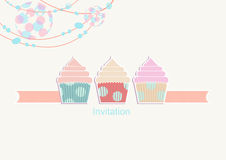 Party invitation with a light and cupcakes Stock Photography