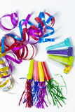 Party items, blowers and colorful streamer Royalty Free Stock Photos