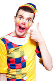 Party Jester Giving A Thumbs Up For Fun On White Stock Images
