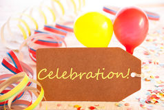 Party Label, Balloon, Streamer, Text Celebration. One Label With English Text Celebration. Party Decoration Like Streamer, Confetti And Balloons. Wooden Royalty Free Stock Photo