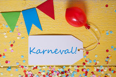 Party Label, Confetti, Balloon, Karneval Means Carnival. White Label With German Text Karneval Means Carnival. Party Decoration Like Streamer, Confetti And stock image