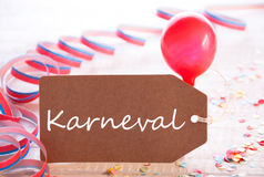 Party Label With Streamer, Balloon, Karneval Means Carnival. One Label With German Text Karneval Means Carnival. Party Decoration Like Streamer, Confetti And stock photos