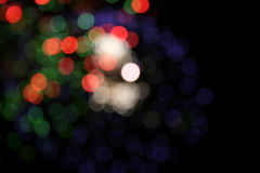 Party lights. Pretty lights at a party. A colorful party background with blurry spots in green, blue, white and red