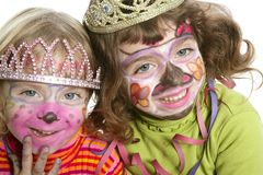 Party little two sisters with painted happy face Royalty Free Stock Photos
