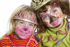 Party little two sisters with painted happy face Stock Photo